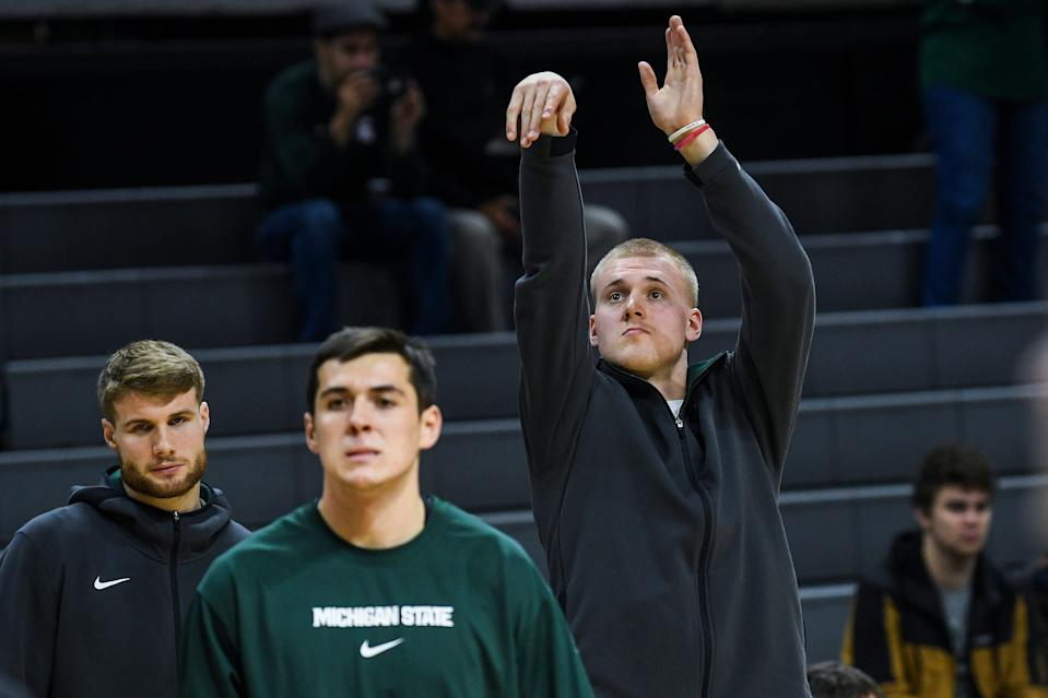 Michigan State's Joey Hauser, right, practices shooting before the Spartans game against Albion on Tuesday, Oct. 29, 2019, at the Breslin Center in East Lansing.
