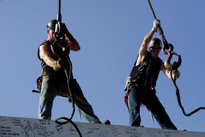In this Thursday, Aug. 2, 2012 photo, ironworkers James Brady, left, and Billy Geoghan release the cables from a steel beam after connecting it on the 104th floor of 1 World Trade Center, in New York. U.S. employers added 163,000 jobs in July, a hopeful sign after three months of sluggish hiring. The Labor Department said Friday, Aug. 3, 2012, that the unemployment rate rose to 8.3 percent from 8.2 percent in June. July's hiring was the best since February. Still, the economy has added an average of 151,000 jobs a month this year, roughly the same as last year's pace. That's not enough to satisfy the 12.8 million Americans who are unemployed. (AP Photo/Mark Lennihan)
