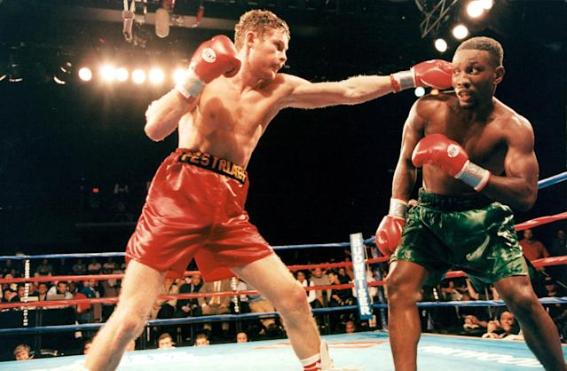 Andrey Pestryaev (L) lands a punch against Pernell Whitaker during the fight at the Foxwoods Resort, on October 17,1997 in Mashantucket, Connecticut. (Photo by: The Ring Magazine via Getty Images)