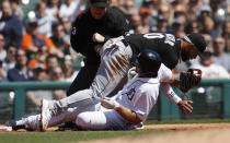 Detroit Tigers' John Hicks, right, is tagged out by Chicago White Sox third baseman Yoan Moncada, left, on a triple attempt during the third inning of a baseball game, Sunday, April 21, 2019, in Detroit. (AP Photo/Carlos Osorio)