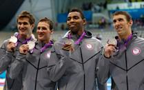<b>Medal No. 17</b><br>From left to right, Adrian Nathan, Ryan Lochte, Cullen Jones and Michael Phelps pose with the silver medals won during the Men's 4 x 100m Freestyle Relay final on Day 2 of the London 2012 Olympic Games.