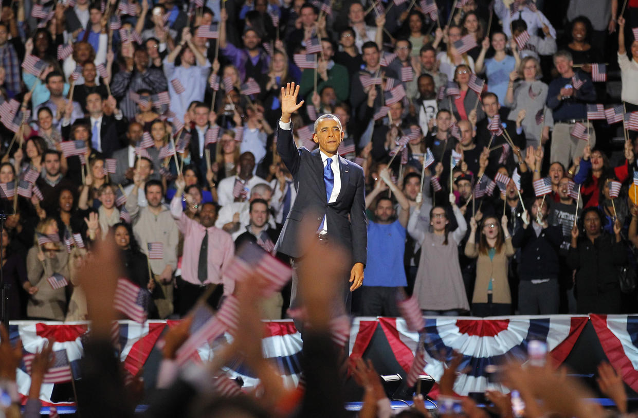 President Barack Obama waves after his victory speech in Chicago in November 2012. (Photo: Jerome Delay/AP)