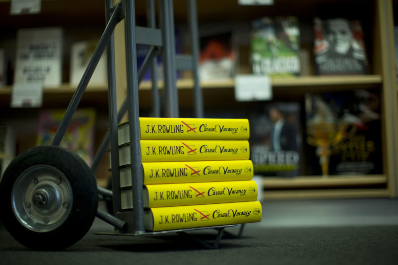 "Copies of the ""The Casual Vacancy"" by author J.K. Rowling stand on a trolley ready to go on the shelves at a book store in London, Thursday, Sept. 27, 2012.  British bookshops are opening their doors early as Harry Potter author J.K. Rowling launches her long anticipated first book for adults.  Publishers have tried to keep details of the book under wraps ahead of its launch Thursday, but ""The Casual Vacancy"" has gotten early buzz about references to sex and drugs that might be a tad mature for the youngest ""Potter"" fans.  (AP Photo/Matt Dunham)"