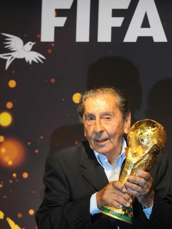 Uruguayan former footballer Alcides Ghiggia, pictured with the World Cup trophy in 2014, scored the goal that won the 1950 World Cup and sparked the 'Maracanazo' trauma that took Brazil decades to overcome (AFP Photo/Miguel Rojo)