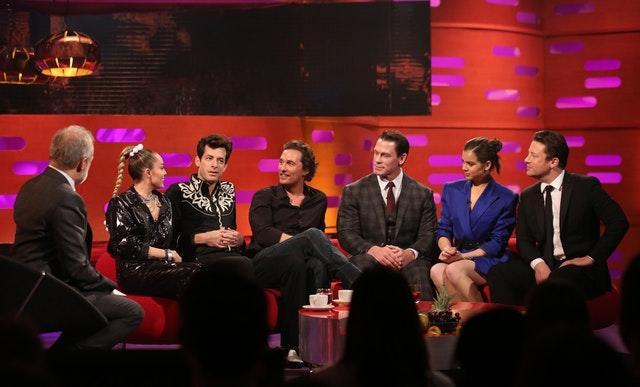(left to right) Host Graham Norton, Miley Cyrus, Mark Ronson, Matthew McConaughey, John Cena, Hailee Steinfeld, and Jamie Oliver filming for The Graham Norton Show