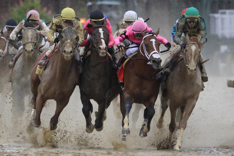 Image: Maximum Security, ridden by jockey Luis Saez, fights for position at the final turn of the Kentucky Derby at Churchill Downs on May 4, 2019. (Andy Lyons / Getty Images)