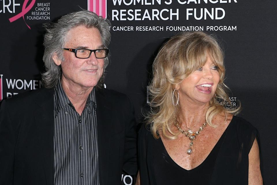 Kurt Russell wears a black suite and Goldie Hawn wears a black dress at the Women's Cancer Research Fund in 2019