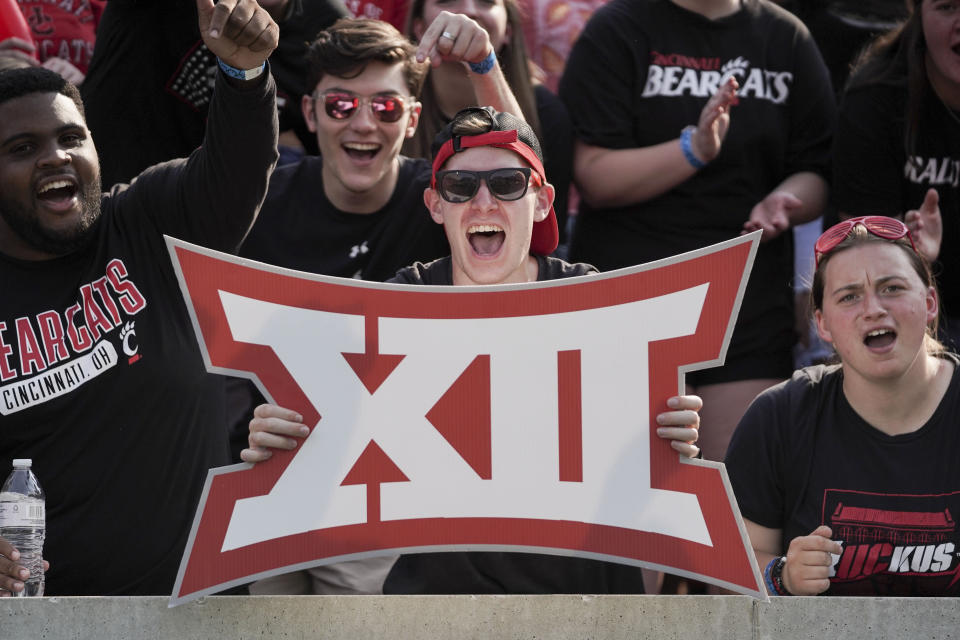 A Cincinnati fan holds a sign during the first half of an NCAA college football game against Murray State, Saturday, Sept. 11, 2021, in Cincinnati. (AP Photo/Jeff Dean)