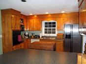 <p>These old wooden cabinets and hardware made the room appear dark and dated.</p>