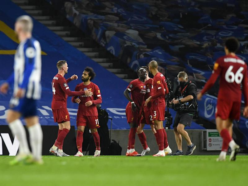 Liverpool celebrate Mohamed Salah's second and their third of the evening: Getty Images