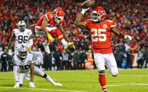 Kansas City Chiefs running back LeSean McCoy (25) celebrates as he runs for a touchdown against the Oakland Raiders during the second half at Arrowhead Stadium - Credit: USA Today