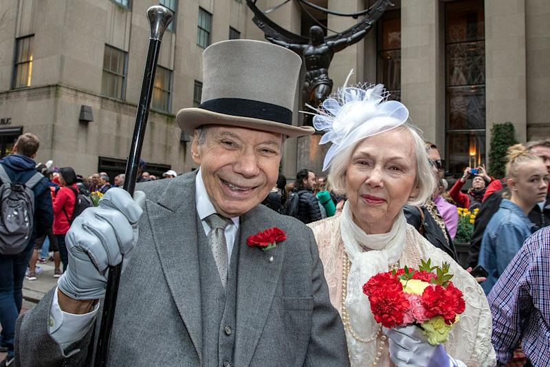 Sam and Mary Bishop of New York City wear costumes and hats attend the annual Easter Parade and Bonnet Festival on April 21, 2019 in New York. (Photo: Gordon Donovan/Yahoo News)