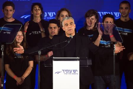 Yair Lapid (C), head of Yesh Atid party, speaks to supporters during a conference in Holon near Tel Aviv March 12, 2015.  REUTERS/Amir Cohen