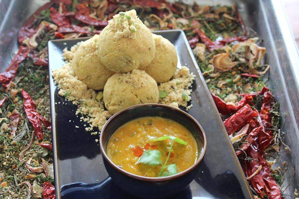 <p>A favorite dal preparation across Marwadi & Rajasthani homes. Mixed lentils (dal) is served with thick, round wheat flour bread & often a dessert -Churma. To make dal, boil 10gms each of Toor dal, Black Urad dal, Chana dal & split Moong dal along with salt, reserve. Heat 1 tsp ghee in a kadhai, add cumin seeds, whole garam masala, one chopped onion & cook until it is light brown. Add one chopped tomato & red chili powder, salt & turmeric powder to taste. Mix well. Add boiled dal & cook for sometime. Add chopped fresh coriander. To make batti- Make dough from 150 gms wheat flour & 100 gms ghee & enough water. Make 3 to 4 dough balls of equal proportions. Cook in the oven at 160 degrees. Arrange the baatis on a serving plate, break each baati into two pieces and pour melted ghee on the baatis. Serve with dal. Image & recipe- Maharaja Jankidas Vaishnav, Sofitel Mumbai BKC </p>