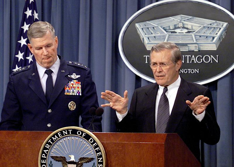 Secretary of Defense Donald Rumsfeld, right, and Gen. Richard B. Myers, chairman of the Joint Chiefs of Staff, hold a news briefing, March 25, 2002, in Washington. (Joe Marquette/AP Photo)