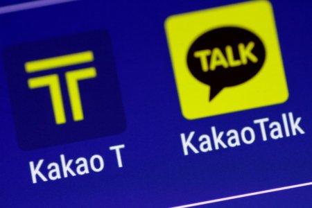 The Kakao messaging application and the Kakao T taxi booking application are seen on a mobile phone in this illustration photo March 13, 2018. REUTERS/Thomas White/Illustration
