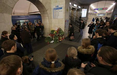People mourn next to memorial site for victims of blast in St. Petersburg metro, at Tekhnologicheskiy institut metro station in St. Petersburg