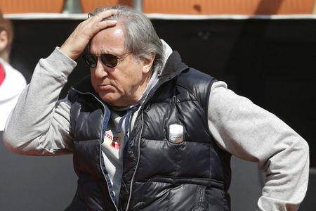 Romania's head coach Ilie Nastase reacts while watching the FedCup Group II play-off match between Romania and Great Britain, in Constanta county