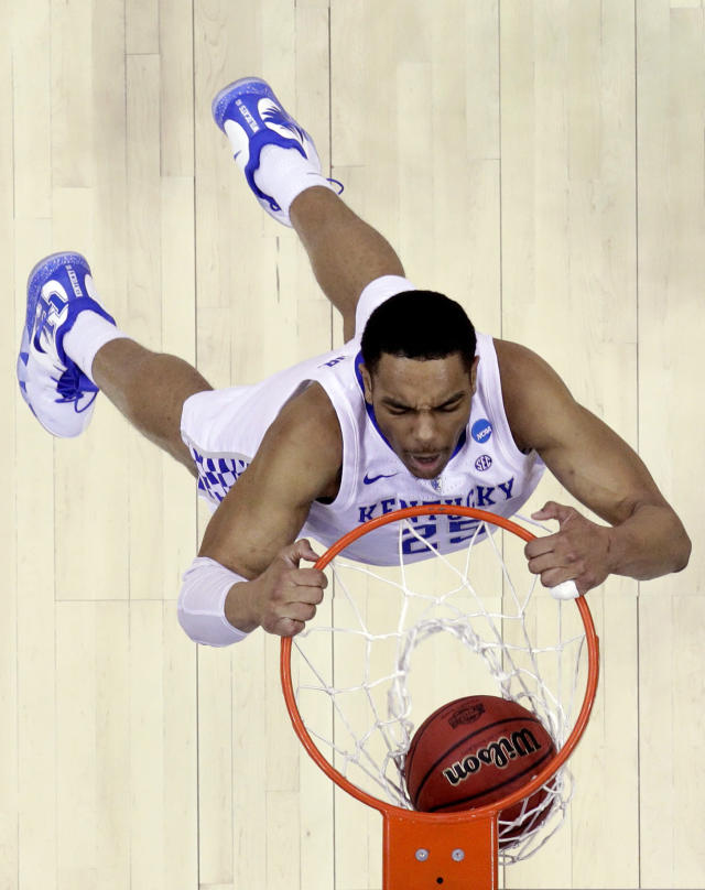 FILE - In this March 31, 2019, file photo, Kentucky's PJ Washington dunks the ball during the second half of the Midwest Regional final game against Auburn in the NCAA men's college basketball tournament in Kansas City, Mo. Washington brings length and athleticism inside along with the ability to step out of the paint, which could have him go late in the lottery at the NBA draft. (AP Photo/Charlie Riedel, File)