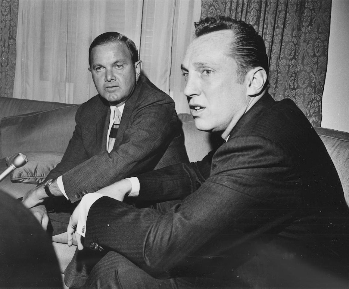 FILE - In this April 1966, file photo, Al Davis, right, the head coach-general manager of the Oakland Raiders, was named the new American Football League Commissioner in Houston by Ralph Wilson, left, President of the AFL and owner of the Buffalo Bills. Bills owner Wilson Jr. has died at the age of 95. NFL.com says team president Russ Brandon announced his death at the league's annual meeting in Orlando, Fla., Tuesday, March 25, 2014. He was one of the original founders of the American Football League and owned the Bills for the last 54 years. (AP Photo/Ed Kolenovsky, File)