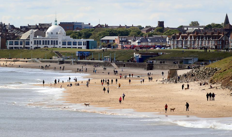 Whitley Bay beach as people are urged not to flock to coastal towns and mational parks across England during the warm weather. (Photo by Owen Humphreys/PA Images via Getty Images)