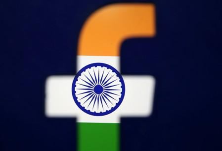 India's flag is seen through a 3D printed Facebook logo in this illustration picture