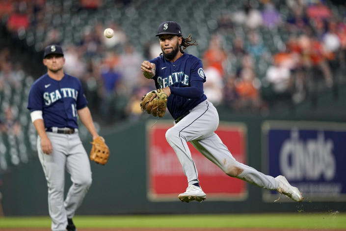 Seattle Mariners shortstop J.P. Crawford throws to first for the out after fielding a ground ball by Houston Astros' Kyle Tucker during the eighth inning of a baseball game Tuesday, Sept. 7, 2021, in Houston. (AP Photo/David J. Phillip)