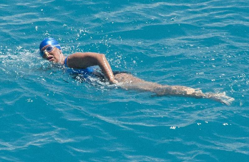 FILE - In this Monday, Sept. 2, 2013 file photo provided by the Florida Keys News Bureau, Diana Nyad, positioned about two miles off Key West, Fla., swims towards the completion of her 111-mile trek from Cuba to the Florida Keys. Nyad's swim from Cuba to Florida has generated some skepticism in the small community of marathon swimmers. Critics have suggested that during a speedy stretch of the 53-hour swim, Nyad might have gotten into or held onto the boat that accompanied her. They also question whether she violated the traditions of her sport by relying on a specialized mask and wetsuit to protect herself from jellyfish.Nyad's navigator and one of the swim's official observers tell The Associated Press that Nyad didn't cheat. (AP Photo/Florida Keys Bureau, Andy Newman, File)