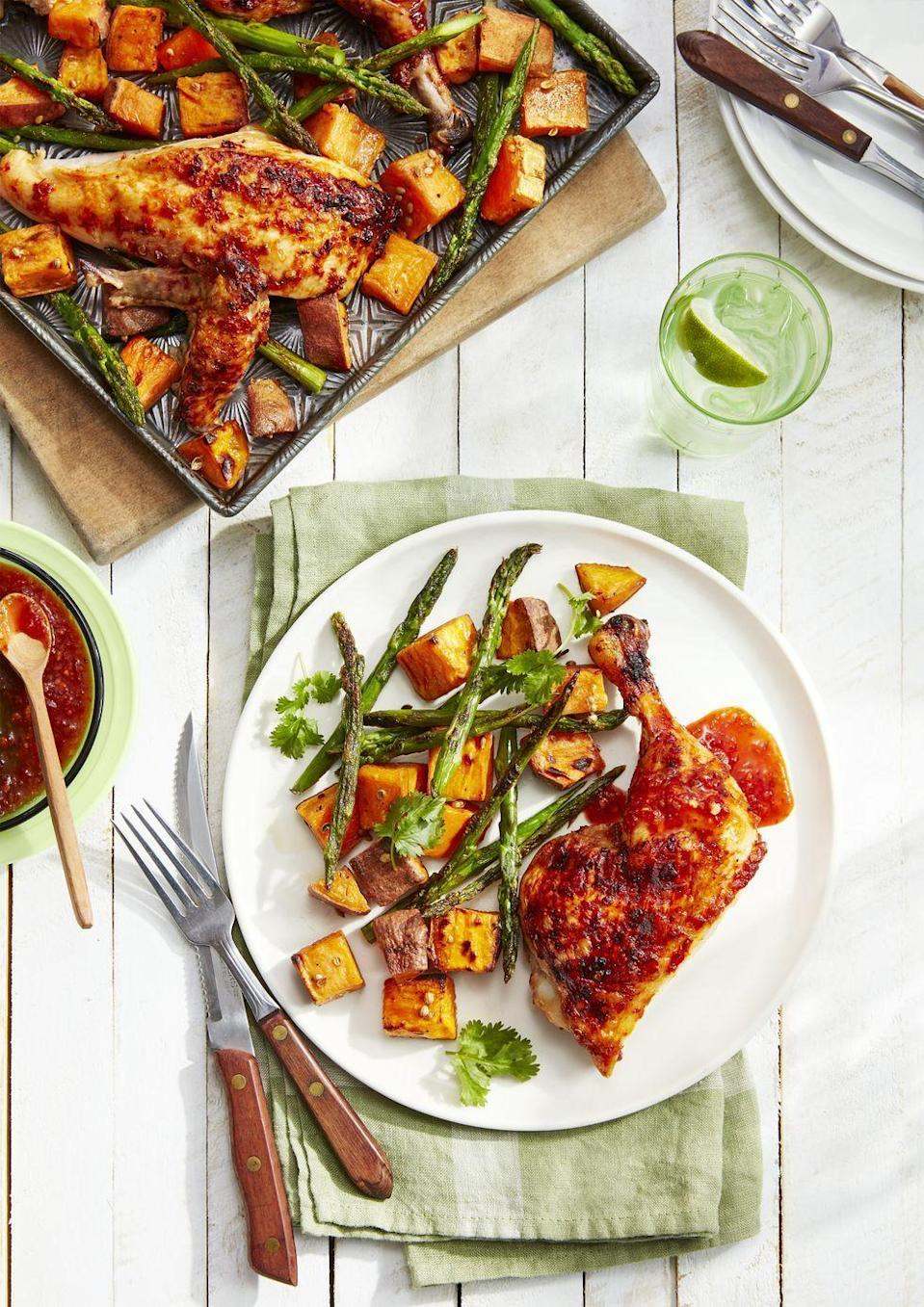 """<p>This easy weeknight dish is packed with flavor, and the leftovers taste delicious reheated <em>or</em> cold. </p><p><strong><a href=""""https://www.countryliving.com/food-drinks/a26434203/sweet-spicy-chicken-roasted-sweet-potatoes-asparagus-recipe/"""" rel=""""nofollow noopener"""" target=""""_blank"""" data-ylk=""""slk:Get the recipe"""" class=""""link rapid-noclick-resp"""">Get the recipe</a>.</strong></p><p><a class=""""link rapid-noclick-resp"""" href=""""https://www.amazon.com/Nordic-Ware-Natural-Aluminum-Commercial/dp/B0049C2S32/?tag=syn-yahoo-20&ascsubtag=%5Bartid%7C10050.g.877%5Bsrc%7Cyahoo-us"""" rel=""""nofollow noopener"""" target=""""_blank"""" data-ylk=""""slk:SHOP SHEET PANS"""">SHOP SHEET PANS</a></p>"""
