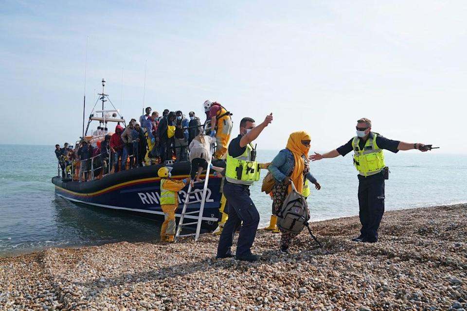 A group of people thought to be migrants are brought ashore from the local lifeboat at Dungeness in Kent, after being picked-up following a small boat incident in the Channel (Gareth Fuller/PA) (PA Wire)