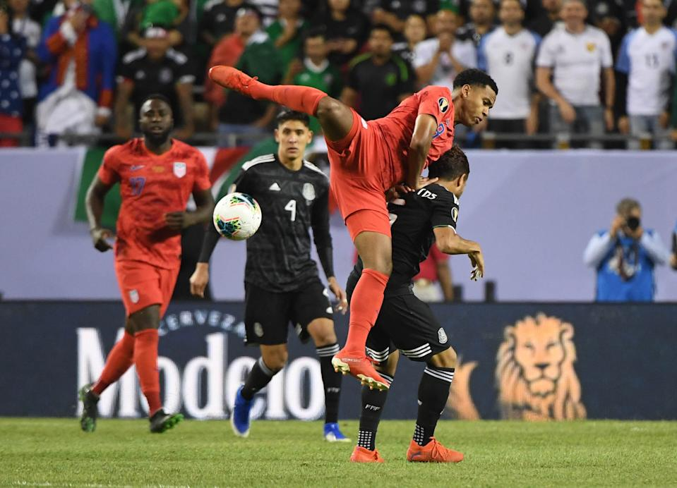 Jul 7, 2019; Chicago, IL, USA; United States midfielder Weston Mckennie (8) battles for the ball with Mexico midfielder Jonathan Dos Santos (6) in the second half championship match of the CONCACAF Gold Cup soccer tournament at Soldier Field. Mandatory Credit: Mike DiNovo-USA TODAY Sports