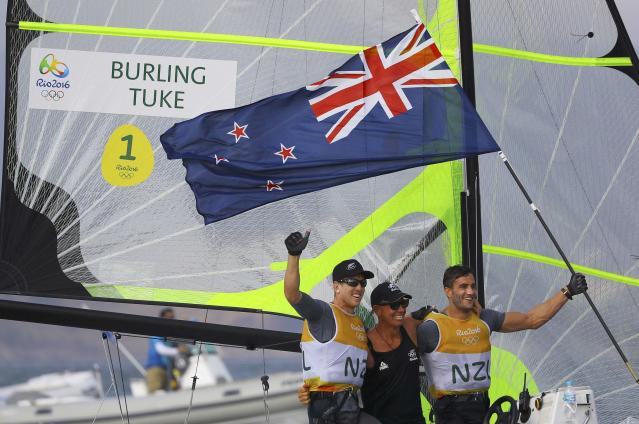 2016 Rio Olympics - Sailing - Final - Men's Skiff - 49er - Medal Race - Marina de Gloria - Rio de Janeiro, Brazil - 18/08/2016. Peter Burling (NZL) of New Zealand and Blair Tuke (NZL) of New Zealand celebrate winning gold medal. REUTERS/Brian Snyder FOR EDITORIAL USE ONLY. NOT FOR SALE FOR MARKETING OR ADVERTISING CAMPAIGNS.
