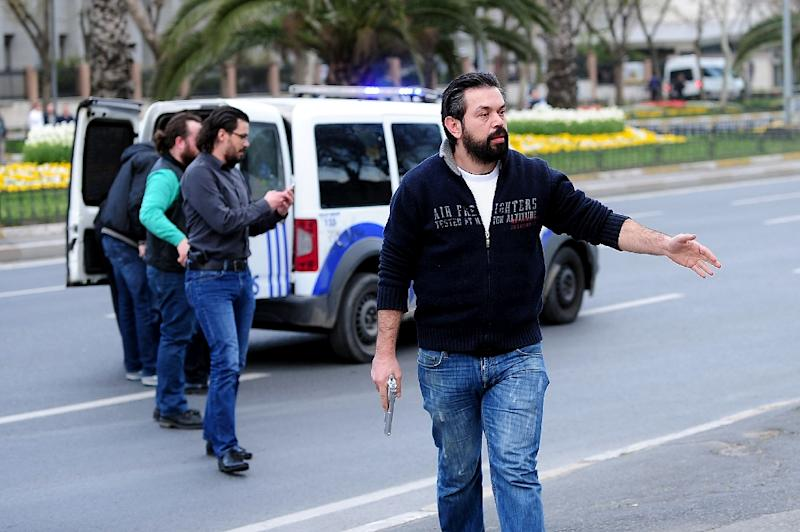 Plainclothes police officers block a street on April 1, 2015 leading to the police headquarters in Istanbul (AFP Photo/Ozan Kose)