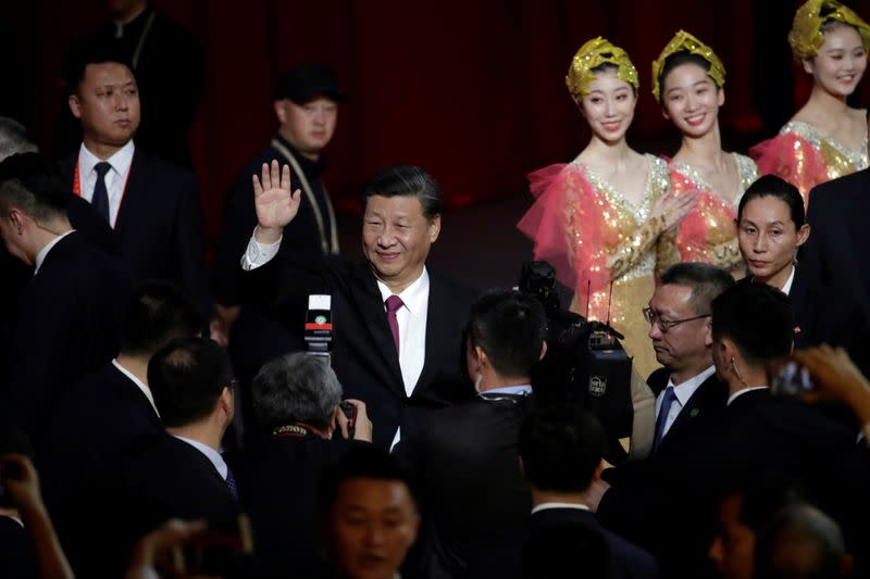 Chinese President Xi Jinping waves his hand to guests during a cultural performance in Macau