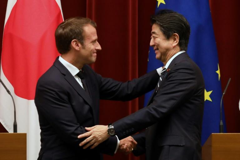At a press conference after meeting Japanese Prime Minister Shinzo Abe, Macron also raised the issue of trade tensions, urging a multilateral approach (AFP Photo/ludovic MARIN)