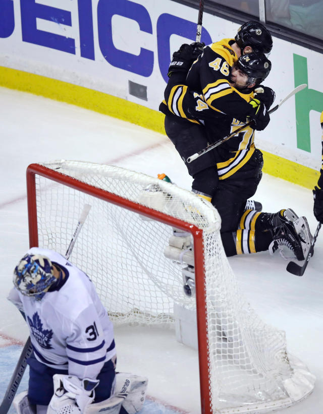 Boston Bruins left wing Jake DeBrusk is embraced by David Krejci (46) after his goal against Toronto Maple Leafs goaltender Frederik Andersen (31) during the third period of Game 7 of an NHL hockey first-round playoff series in Boston, Wednesday, April 25, 2018. (AP Photo/Charles Krupa)