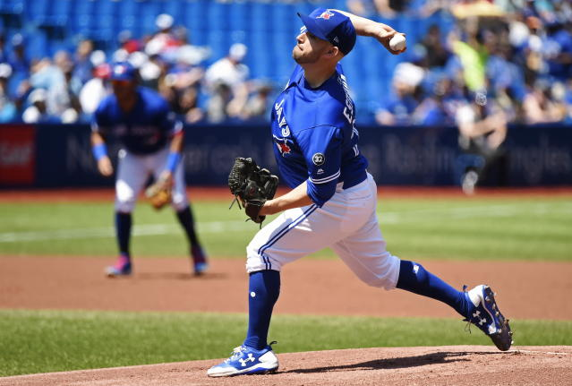 Toronto Blue Jays starting pitcher Marco Estrada (25) works against the Los Angeles Angels during the first inning of a baseball game in Toronto, Thursday, May 24, 2018. (Nathan Denette/The Canadian Press via AP)