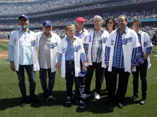 The Beach Boys pose on the field after performing the national anthem before the Los Angeles Dodgers home opener against the Pittsburgh Pirates in Los Angeles, April 10, 2012.