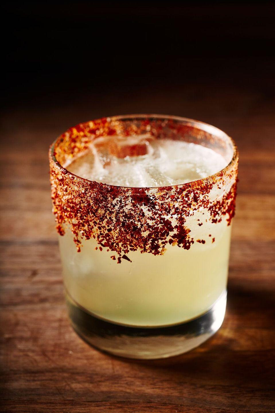 """<p><strong>Ingredients</strong></p><p>2 oz Avion Silver Tequila<br>.5 oz Grand Marnier<br>.5 oz lime juice<br>.5 oz lemon juice<br>1.5 oz Ghost Chili Simple Syrup*</p><p><strong>Instructions</strong></p><p>Add all ingredients together with ice in a cocktail shaker, shake and strain over fresh ice in a rocks glass that has a chili salt rim. Serve with a lime wheel and enjoy.</p><p>*<em>Ghost Chili Simple Syrup</em>: Take 1 cup of water and 1 cup of brown demerara with one dried ghost chili pepper, bring to a boil and let cool.</p><p><em>Courtesy of Alex Guarnaschelli of <a href=""""http://www.butterrestaurant.com/"""" rel=""""nofollow noopener"""" target=""""_blank"""" data-ylk=""""slk:Butter"""" class=""""link rapid-noclick-resp"""">Butter</a> in New York City</em></p><p><strong>More:</strong> <a href=""""https://www.townandcountrymag.com/leisure/drinks/g3314/tequila-drinks/"""" rel=""""nofollow noopener"""" target=""""_blank"""" data-ylk=""""slk:The Most Exciting Tequila Drinks"""" class=""""link rapid-noclick-resp"""">The Most Exciting Tequila Drinks</a><br></p>"""