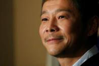 FILE PHOTO: Japanese billionaire Maezawa, founder of online fashion retailer Zozo, who has been chosen as the first private passenger by SpaceX, attends a news conference in Tokyo