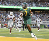 Baylor running back Abram Smith (7) scores a touchdown against Texas Southern in the first half of an NCAA college football game, Saturday, Sept. 11, 2021, in Waco, Texas. (Jerry Larson/Waco Tribune-Herald via AP)