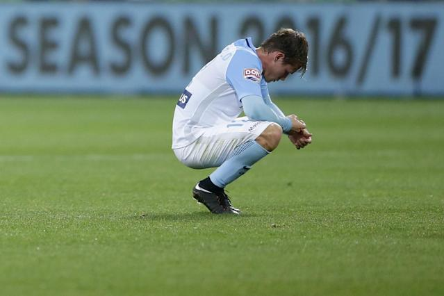 <p>Melbourne City man Nick Fitzgerald looks on bereft as City lose at home to Perth in the A League play-offs </p>