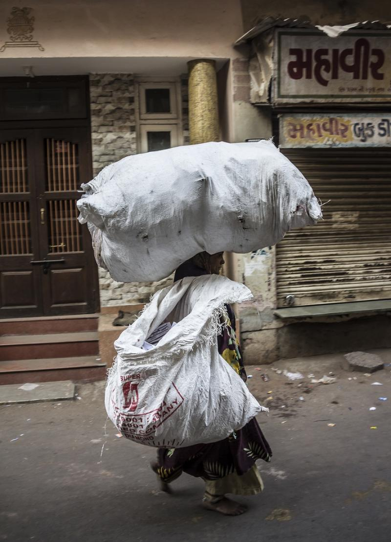 (File photo) A woman collecting waste in the historic old town of Ahmedabad, Gujarat.