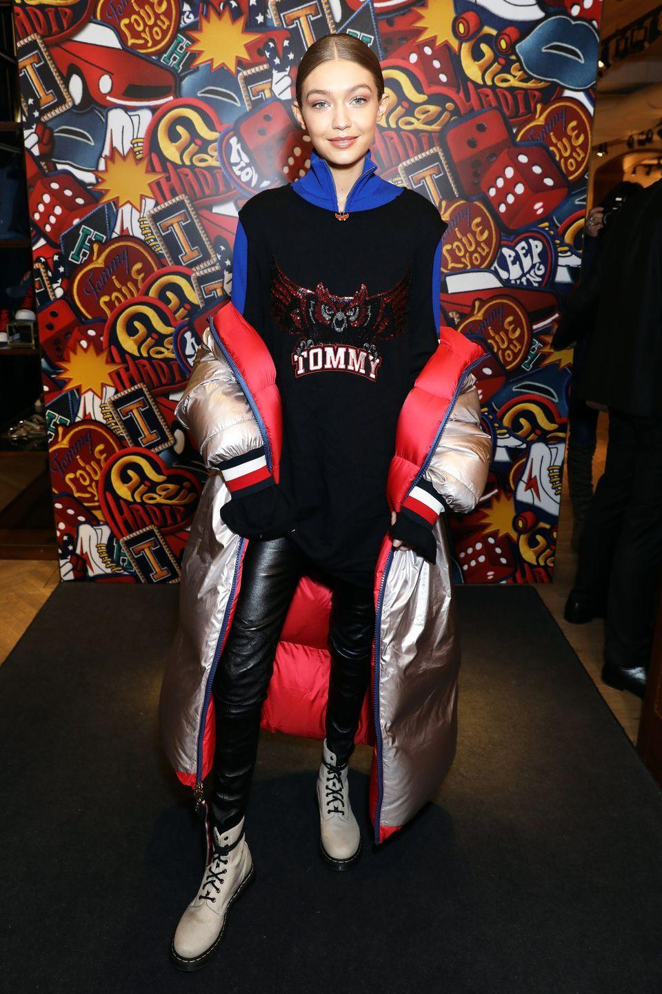 <p>Before her runway duties kicked into full gear, Gigi stopped at a Tommy Hilfiger store in London to promote her latest Tommy x Gigi collab. The model wore a Tommy sweatshirt and silver puffer coat with black leather pants and white Dr. Martens boots. </p>