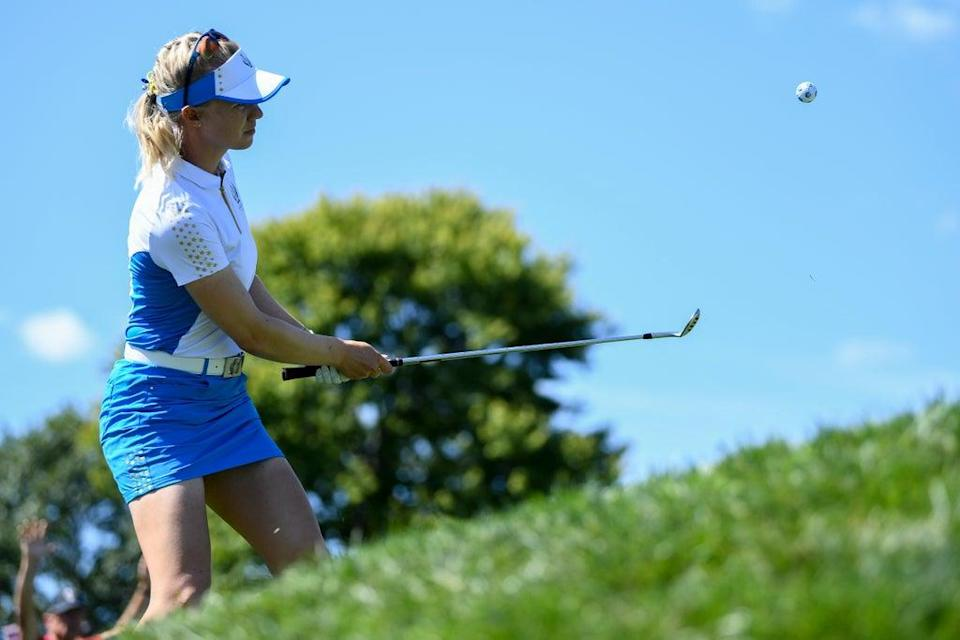 Madelene Sagstrom hits from the rough on the sixth hole during the singles matches at the Solheim Cup (David Dermer/AP) (AP)