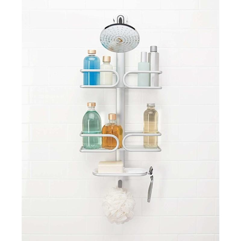 """Get rid of the clutter lining your shower with this rust-proof caddy, <a href=""""https://www.oxo.com/products/storage-organization/bathroom/aluminum-3-tier-shower-caddy"""" target=""""_blank"""">$50</a>."""