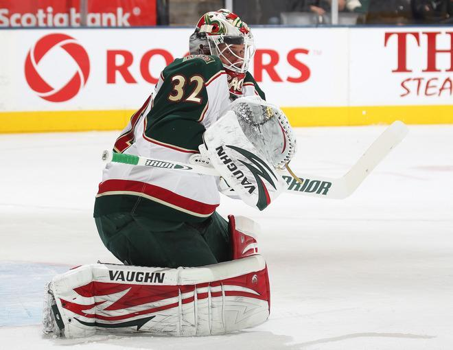 TORONTO, CANADA - JANUARY 19: Niklas Backstrom #32 of the Minnesota Wild takes a shot off the mask in a game against the Toronto Maple Leafs on January 19, 2012 at the Air Canada Centre in Toronto, Ontario, Canada. (Photo by Claus Andersen/Getty Images)