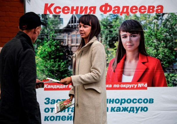 PHOTO: Ksenia Fadeyeva, 28, the head of Alexei Navalny's Tomsk headquarters and the city council candidate in Sept. 13 regional elections, distributes campaign leaflets in the Siberian city of Tomsk on Sept. 7, 2020. (Alexander Nemenov/AFP via Getty Images)