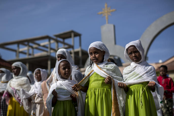 Children and other congregants pray during a Sunday morning service of the Ethiopian Orthodox Tewahedo Church at the Church of St. Mary in Mekele, in the Tigray region of northern Ethiopia Sunday, May 9, 2021. The head of the Ethiopian Orthodox Church, Patriarch Abune Mathias, in a video shot last month on a mobile phone and carried out of Ethiopia, sharply criticized Ethiopia's actions in the conflict in the country's Tigray region. Some thousands of Eritrean refugees are among the most vulnerable groups in the conflict and are increasingly caught in the middle of the conflict in Ethiopia's Tigray region. (AP Photo/Ben Curtis, FILE)