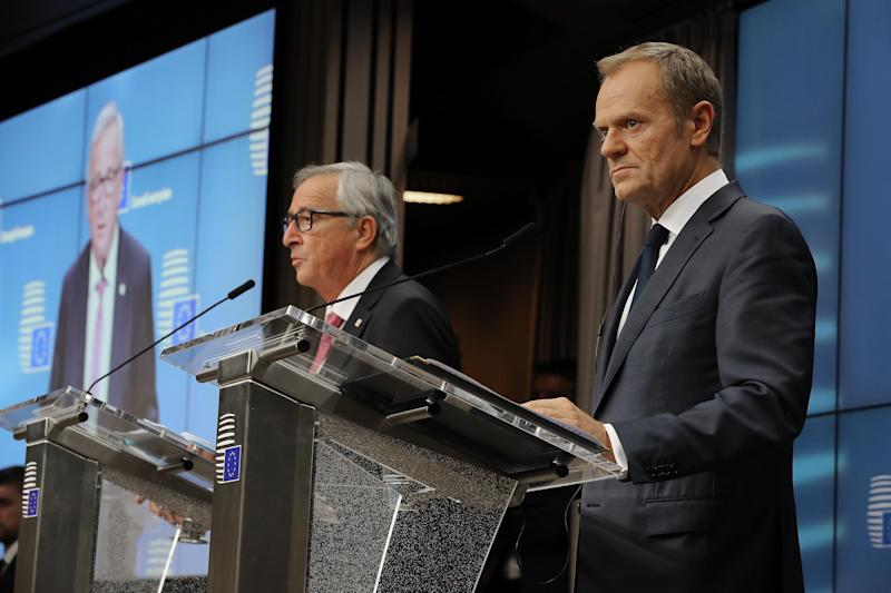 Donald Tusk and Jean-Claude Juncker speak during a press conference: Getty Images